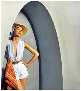 model-in-carolyn-schnurers-white-oxford-cloth-shorts-and-top-with-white-cord-passementerie-based-on-a-djellabah-photo-by-louise-dahl-wolfe-in-tunisia-for-cover-of-harpers-bazaar-june-918x1024